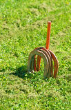 Horse shoe game on lawn Stock Photo