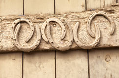 Horse shoes nailed to old wooden door royalty free stock image