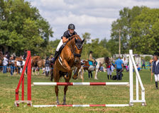 Horse Show Jumping, Hanbury Countryside Show, England. A female competitor on a handsome horse jumping a hurdle during an equestrian event at the Hanbury Stock Photography