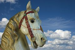 Horse in the sky. Carousel woody horse on sky background Stock Photography