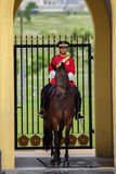Horse Soldier of Malaysia. In red dress Stock Images