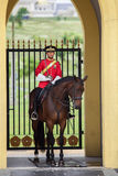 Horse Soldier of Malaysia. In red dress Royalty Free Stock Photography