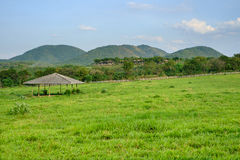 Horse Stable in front of hills. Horse Stable with green grass field in front of hills stock photography