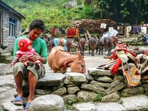 Horse stable and people in Dharapani, Nepal Royalty Free Stock Image