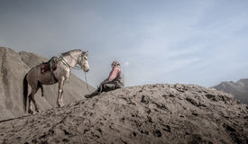 Horse and stableman at Bromo crater Royalty Free Stock Photos
