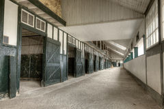 Horse stables. Interior of a barn with empty horse stables Royalty Free Stock Photography