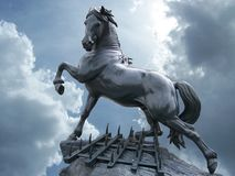 Horse statue. On the sky with clouds stock image