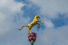 Horse statue. A golden horse statue in Thailand Royalty Free Stock Images