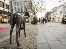 Kristiansand, Norway - November 8, 2017: The horse statue, aka Hesten, in Markensgate. Shopping street with some people. The horse statue is named Fole, but Royalty Free Stock Image