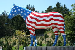Horse statue, painted with American flag. Royalty Free Stock Photo
