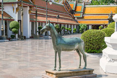 Horse statue at Wat Suthat, royal temple at the Giant Swing in Bangkok in Thailand. Royalty Free Stock Images