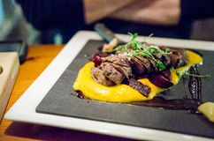 Horse steak. Cooked sous vide with sweet potato puree royalty free stock image