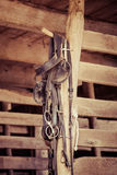 Horse Tack Items. Various horse tack items hang in a stable Stock Photos