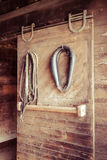 Horse Tack Items. Various horse tack items hang in a stable Royalty Free Stock Images