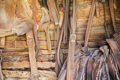 Horse tack leather saddle logs Stock Images