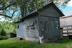 Horse Tack Shed. Rustic and wooden horse tack shed with tools and implements hanging on outside walls Royalty Free Stock Image