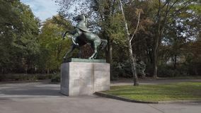 The Horse Tamer In Public Park Kleistpark In Berlin, Germany. In Autumn stock video footage