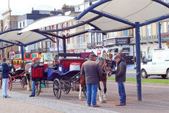 Horse taxi carriages in Great Yarmouth. Horses and carts waiting for fares to taxi people along the sea front in Great Yarmouth United Kingdom Royalty Free Stock Photo