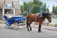 Horse taxi on the street of the provincial Russian city Stock Photo