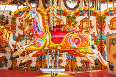 Horse on a traditional fairground vintage carousel in Cardiff. Horse on a traditional fairground vintage carousel located in front of Pierhead Building in Royalty Free Stock Image