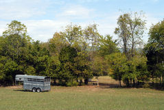 Horse trailer. Parked in field next to horse pasture in countryside Stock Photo