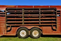 Horse trailer with attached corral sections. A parked horse trailer with sections of a portable corral attached to the side Stock Photos