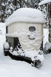 A horse trailer covered in snow. A horse trailer covered in white snow Stock Image