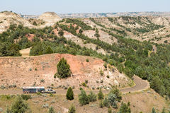Horse Trailer, Mountain Road, Travel. Horse trailer being pulled by a truck going through the badlands of North Dakota at Theodore Roosevelt National Park in the Stock Photography