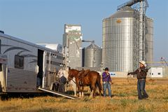 Horse trailer and steel grain silo in Dupree royalty free stock photo