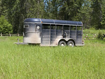 Horse trailer in tall green grass Stock Images