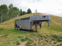 Horse trailer. Unused horse trailer parked on a green hill Stock Image