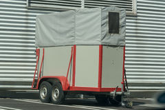 Horse transport trailer. Old horse transport trailer in front of a metal wall Stock Photography