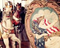 Horse in a vintage carousel Stock Photos