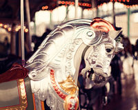 Horse in a vintage carousel. Horse in a vintage pastel carousel Royalty Free Stock Images