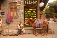 Horse waiting tourists in Shuhe ancient town. Royalty Free Stock Photos