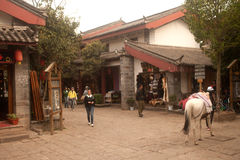Horse walk in evening ,Shuhe ancient town. Royalty Free Stock Image