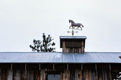 Horse weather vane on roof. Royalty Free Stock Photo