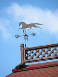 Horse weathervane. Blue sky arrow Royalty Free Stock Photos