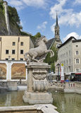 Horse Well in Salzburg with a horse sculpture stock image
