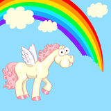 Horse with wings eating a rainbow Stock Photo