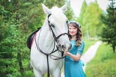Horse and woman Royalty Free Stock Image