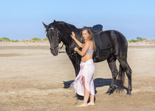 Horse woman on the beach Stock Image