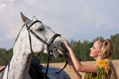 Horse and woman face to face Stock Photo