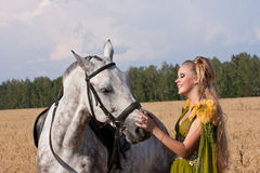 Horse and woman face to face Royalty Free Stock Images