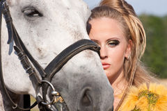 Horse and woman face to face Stock Photos