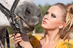 Horse and woman face to face Stock Images