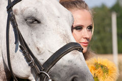 Horse and woman face to face Stock Photography