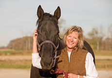 Horse and Woman Laughing Stock Image