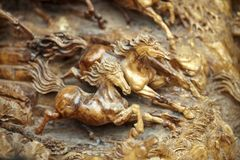 Horse wood carve Stock Photos