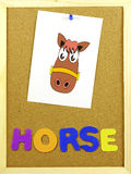 Horse word on a corkboard Stock Photos
